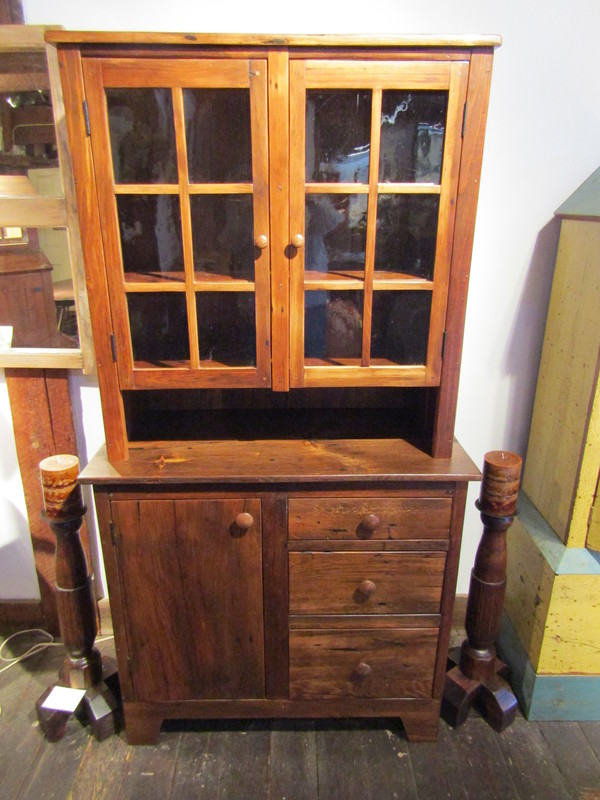 2 Piece Hutch made from Antique Pine with 3 drawers and 1 door in the base.  Top features 3 shelves and two glass doors. 38 1/4
